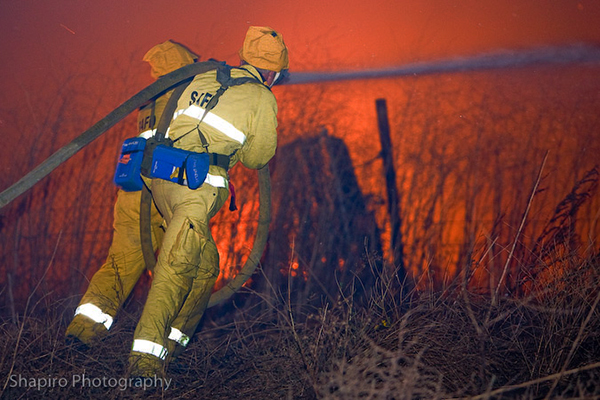 firemen fighting a wild land fire in California