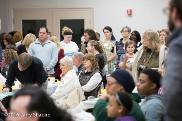 volunteers and guests at a community Thanksgiving dinner