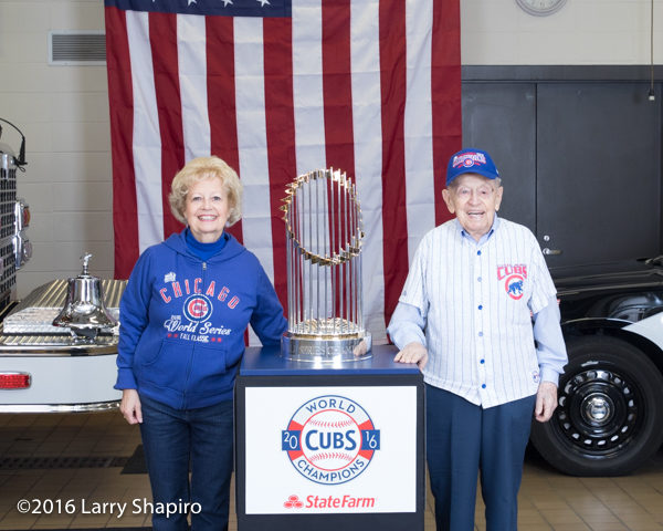 older couple posing with the world series championship trophy