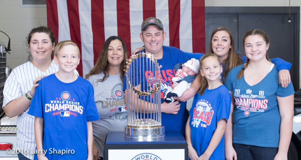 family with the world series championship trophy