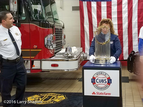 MLB handler with the world series championship trophy