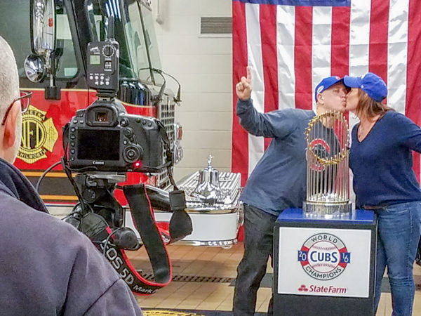 couple poses with the World Series championship trophy